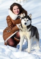 17643436-woman-with-dog-husky-in-the-winter